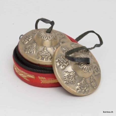 cymbale tibétain et pochette rouge