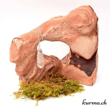 acheter une pendule arrondis en cristal de roche proche de la chaud de fonds