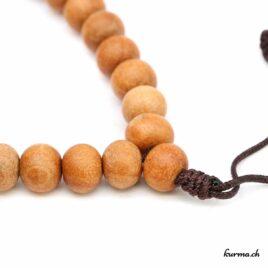 Bracelet en bois beige avec une ficelle 8mm
